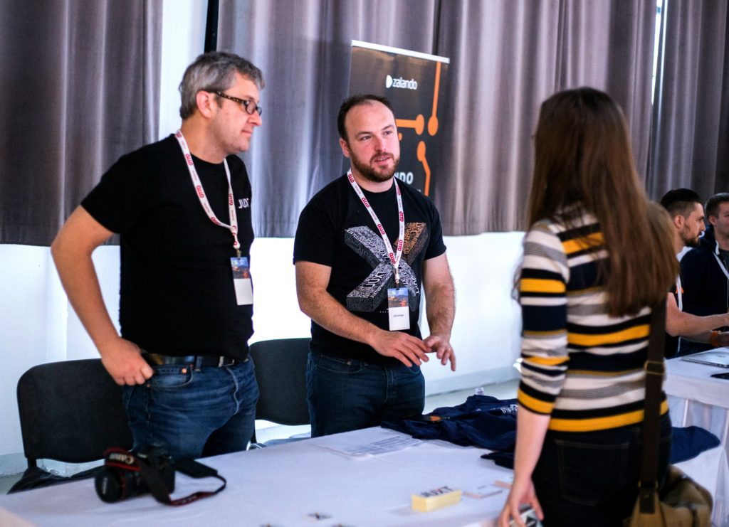 EuroClojure 2016 Sponsors Malcolm Sparx & Jon Pither from Juxt at their sponsorship table.